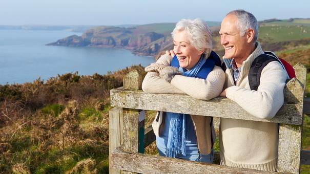 senior_couple_walking_along_coastal_path.jpg